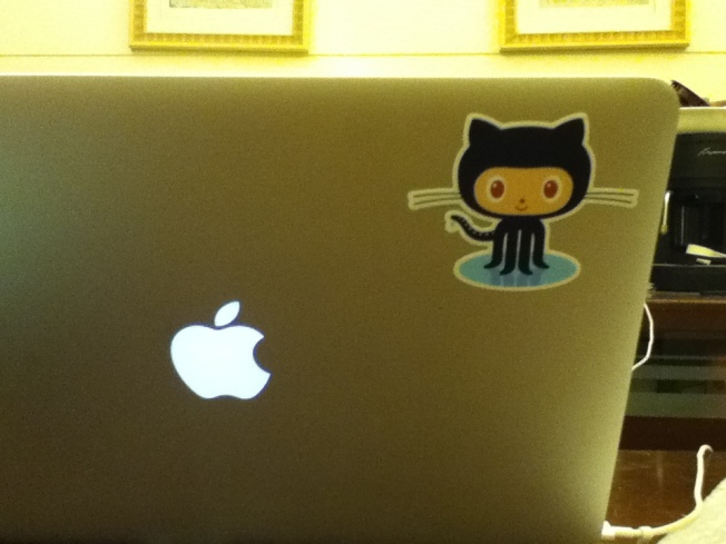 [Picture of octocat sticker on Mac]