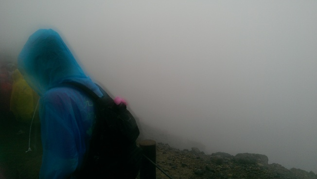 [The view of Heaven Lake: a guy in a blue raincoat and featureless white mist]